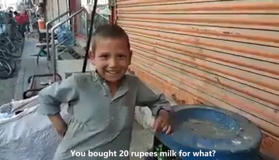 Street Kid Buys Milk for Stray Cat